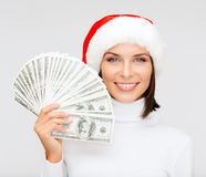 Woman in santa helper hat with us dollar money. Christmas, x-mas, sale, banking concept - smiling woman in santa helper hat with us dollar money Stock Photography