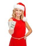Woman in santa helper hat with us dollar money Stock Photo
