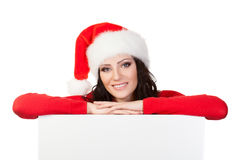 Woman santa helper over blank board Royalty Free Stock Photos