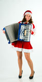 Woman santa-klaus plays for all an accordion Stock Photography