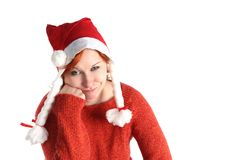 Woman in santa's cap isolated Stock Images