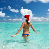 Woman in santa's hat at beach Stock Photography