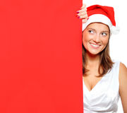 Woman in Santa's hat holding a blank board Royalty Free Stock Image