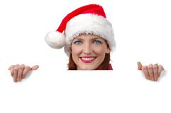 Woman with Santa's hat holding blank sign Stock Images