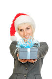 Woman in santa's hat holding gift box Royalty Free Stock Images