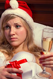 Woman in Santa's hats  remain all alone Stock Image