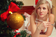 Woman in Santa's hats  remain all alone Stock Images
