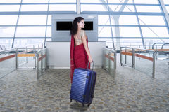 Woman with saree clothes and bag in airport Royalty Free Stock Photo