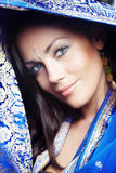 Woman in sari. Beautiful lady in the blue traditional sari. Close-up portrait. India stock photography