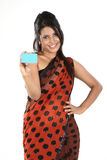 Woman in sari  with credit card. Beautiful woman holding empty credit card Stock Photos