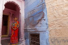 Woman in sari at the door of her house in Jodhpur Royalty Free Stock Photo
