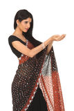 Woman in sari with holding action Royalty Free Stock Photo
