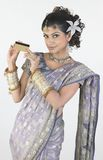 Woman in sari holding credit card Royalty Free Stock Images