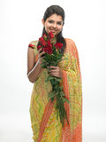 Woman in sari holding red roses Royalty Free Stock Photos