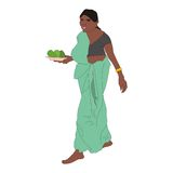 Woman sari. Married woman wearing a green sari with a plate of avocado in her hands Royalty Free Stock Images