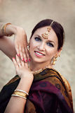 Woman in sari with oriental makeup and jewelry Royalty Free Stock Photography