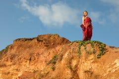 Woman in a sari on Sri Lanka beach. stock images