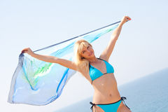 Woman with sarong. Beautiful woman with sarong in the wind Royalty Free Stock Images
