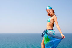 Woman with sarong. Beautiful woman with seascape on background Royalty Free Stock Photos