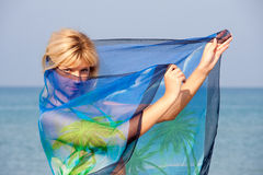 Woman with sarong. Beautiful woman with sarong in the wind Stock Image