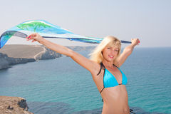 Woman with sarong. Beautiful woman with sarong in the wind Royalty Free Stock Photography
