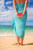 Woman sarong beach. Woman on beach with tropical sarong and flower relaxing Royalty Free Stock Photos