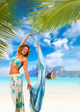 Woman with sarong on the beach Royalty Free Stock Image