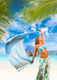Woman with sarong on the beach Royalty Free Stock Photos