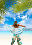 Woman with sarong on the beach Royalty Free Stock Images