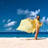 Woman with sarong at beach Royalty Free Stock Image