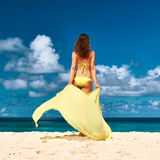 Woman with sarong at beach Stock Images
