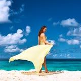 Woman with sarong at beach Royalty Free Stock Images