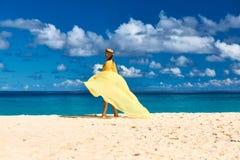 Woman with sarong at beach Stock Photos