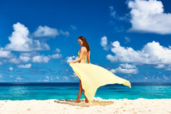 Woman with sarong at beach Stock Photography