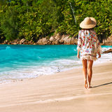 Woman with sarong on beach at Seychelles Royalty Free Stock Photo