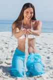 Woman in sarong playing with sand Royalty Free Stock Images
