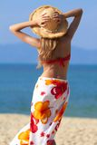 Woman in sarong and straw hat Stock Photo