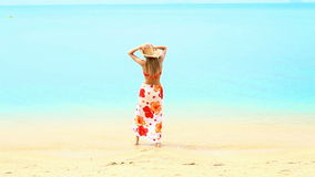 Woman in sarong and straw hat at the beach stock video footage