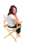 Woman sat on a chair looking back Stock Photos