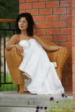 Woman sat in chair in wedding dress Stock Images