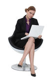 Woman sat in designer chair Royalty Free Stock Photo