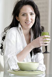 Woman sat at the dinner table Stock Image