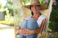 Woman sat in a hammock Stock Images