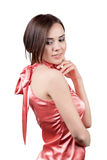 Woman in satin dress. Portrait of a beautiful young woman in a red satin dress isolated on white background royalty free stock photos