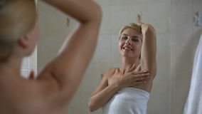 Woman satisfied with soft skin of armpit, high quality antiperspirant, body care. Stock footage stock video