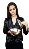 Woman with sauce pan Stock Image