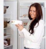 Woman with saucepan Stock Image