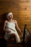 Woman in sauna Stock Image