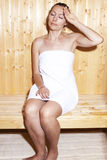 Woman in sauna Stock Images