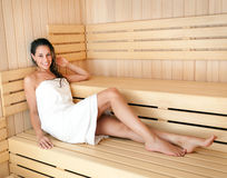 Woman in the sauna. Young woman relaxing in a sauna Royalty Free Stock Image